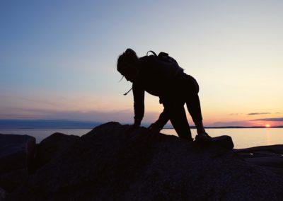 Climbing rock at Peggy's Cove, Nova Scotia